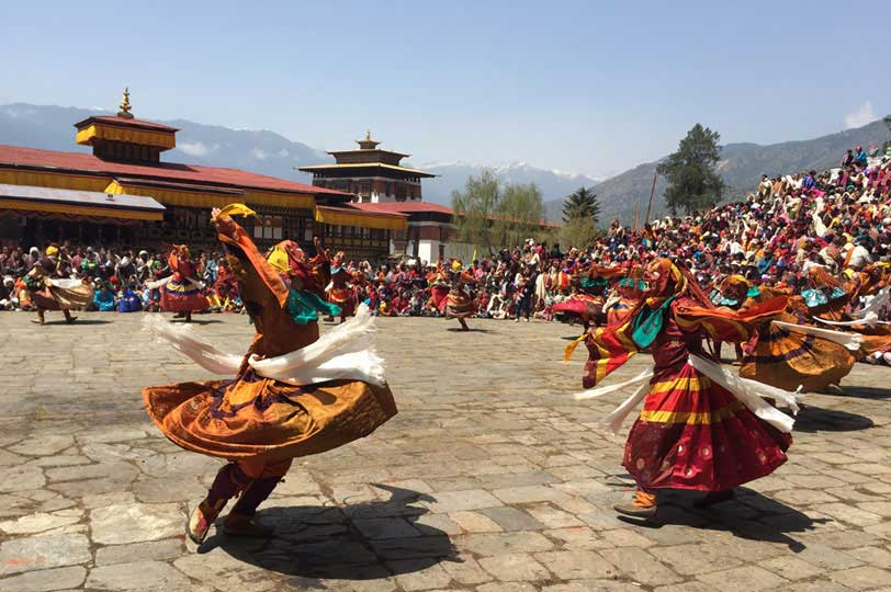 Mask Dancers performing sacred dances during Paro Tshechu Festival
