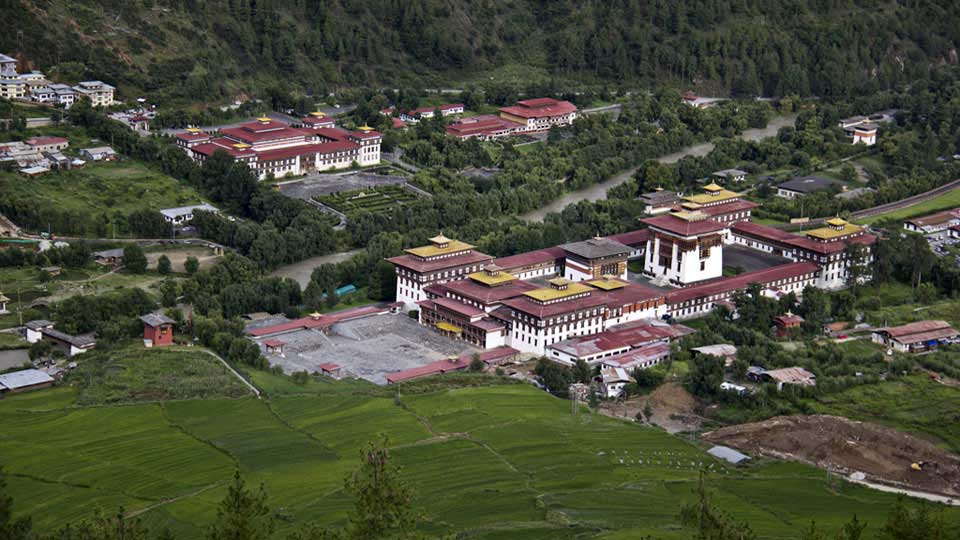 View of Tashichho Dzong with National Assembly Hall and National Council building in the background - The capital city of Bhutan