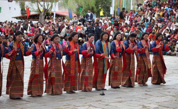 Women Folk Dancers performing tradition dance at Paro Tshechu festival in Bhutan