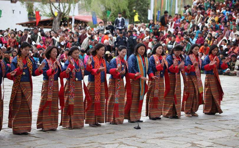 Women Folk Dancers performing tradition dance at Paro Tshechu festival in Bhutan