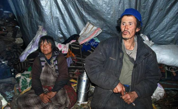 Yak herder couple near Jimilang Tsho, campsite three of Druk Path Trek - Bhutan