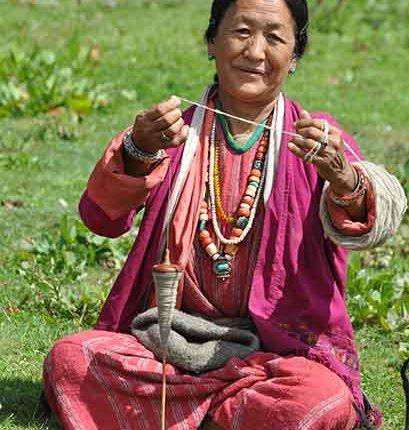 Brokpa woman spinning yak hair
