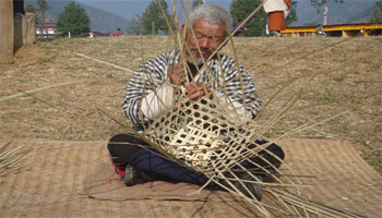 Men making bamboo basket in Bhutan