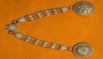 A pair of brooch used by Bhutanese women as an ornament.