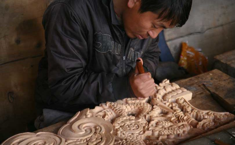A wood carver at work, Bhutan.