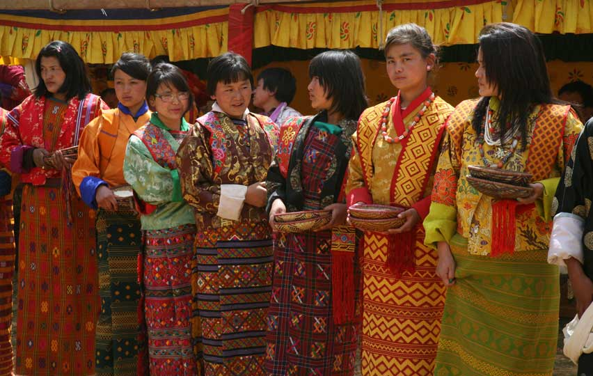 Women wearing traditional Bhutan dress called Kira during an annual festival in one of the remote villages in Bhutan