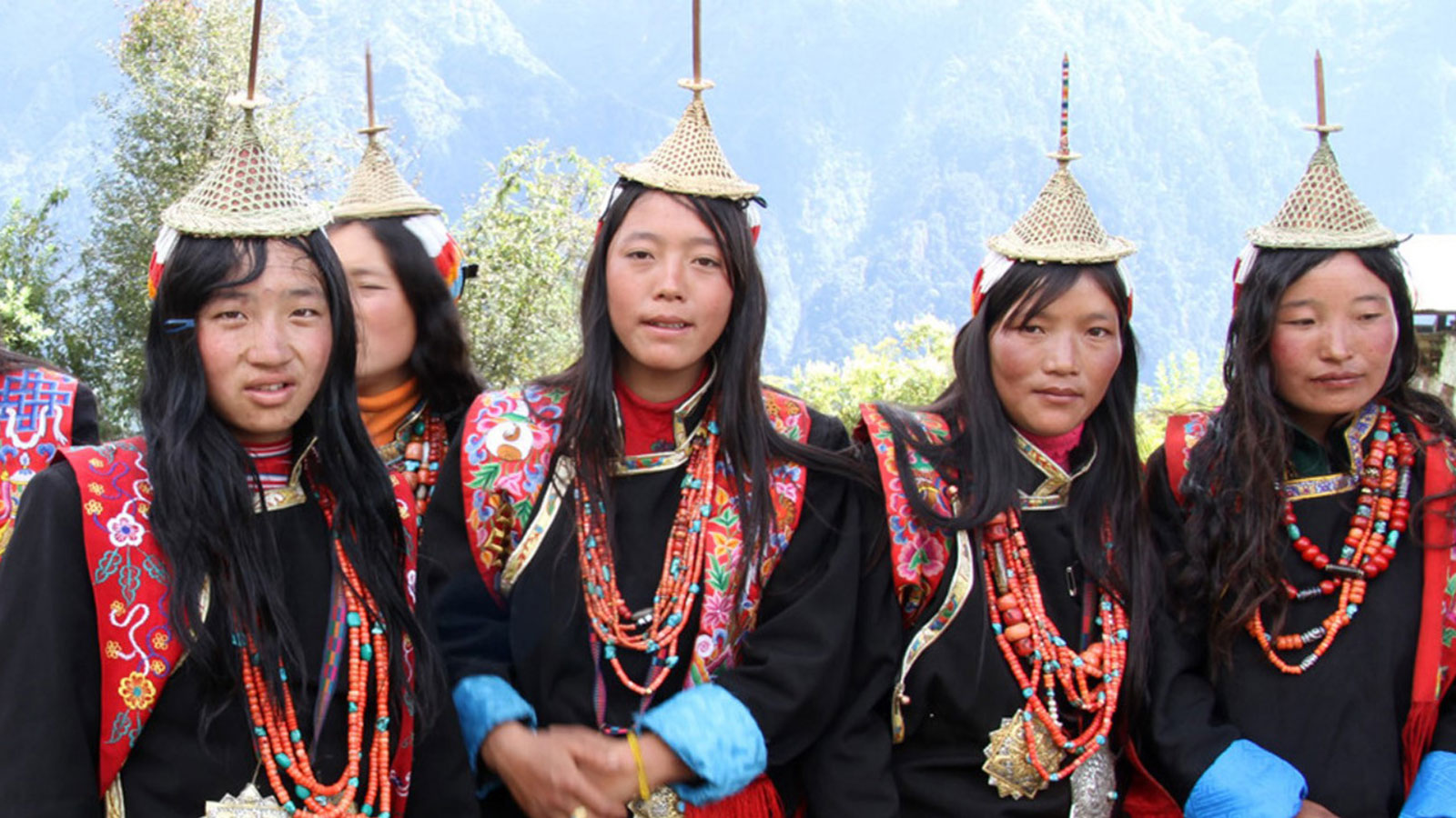 Women from Laya in their unique costume during the highland festival
