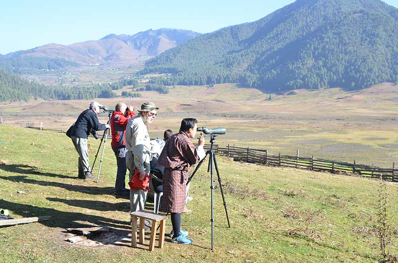Observing birds in Phobjikha Valley