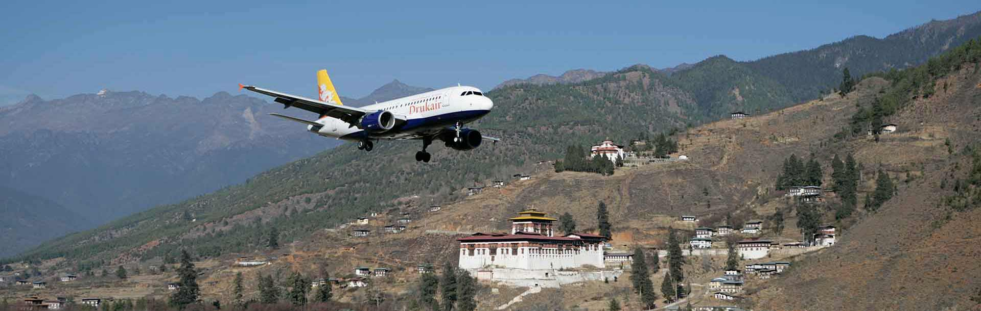 The flag carrier, Drukair, just taking off from the only International Airport in Bhutan, Paro.