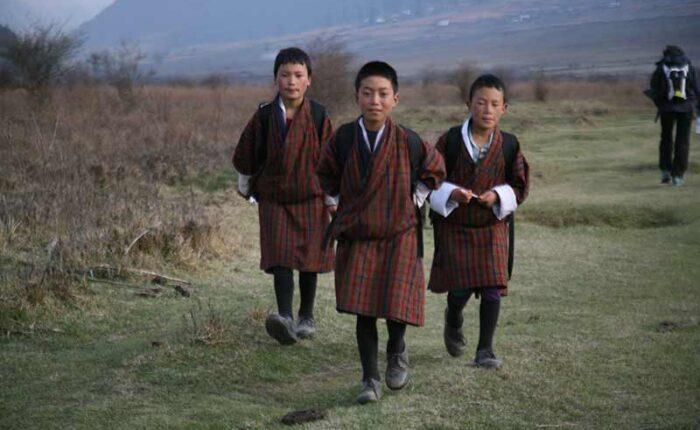 School kids walking back home in rural Bhutan